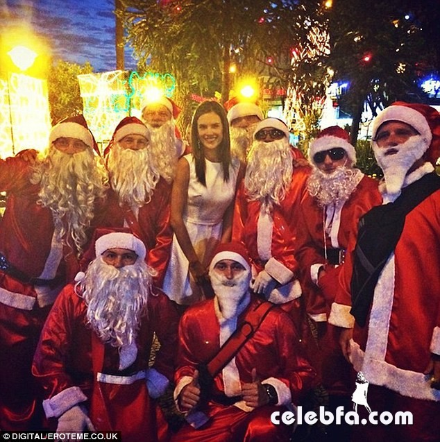 2442916400000578-2887123-And_who_are_these_cute_men_The_model_with_nearly_a_dozen_Santas_-a-11_1419538906815