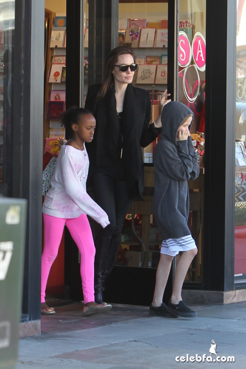 EXCLUSIVE: Angelina Jolie teaches her kids the finer points in retail therapy