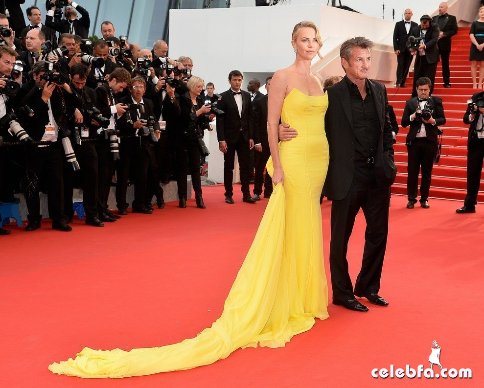 "CANNES, FRANCE - MAY 14:  Actor Sean Penn and Actress Charlize Theron attend the premiere of ""Mad Max: Fury Road"" during the 68th annual Cannes Film Festival on May 14, 2015 in Cannes, France.  (Photo by Pascal Le Segretain/Getty Images)"