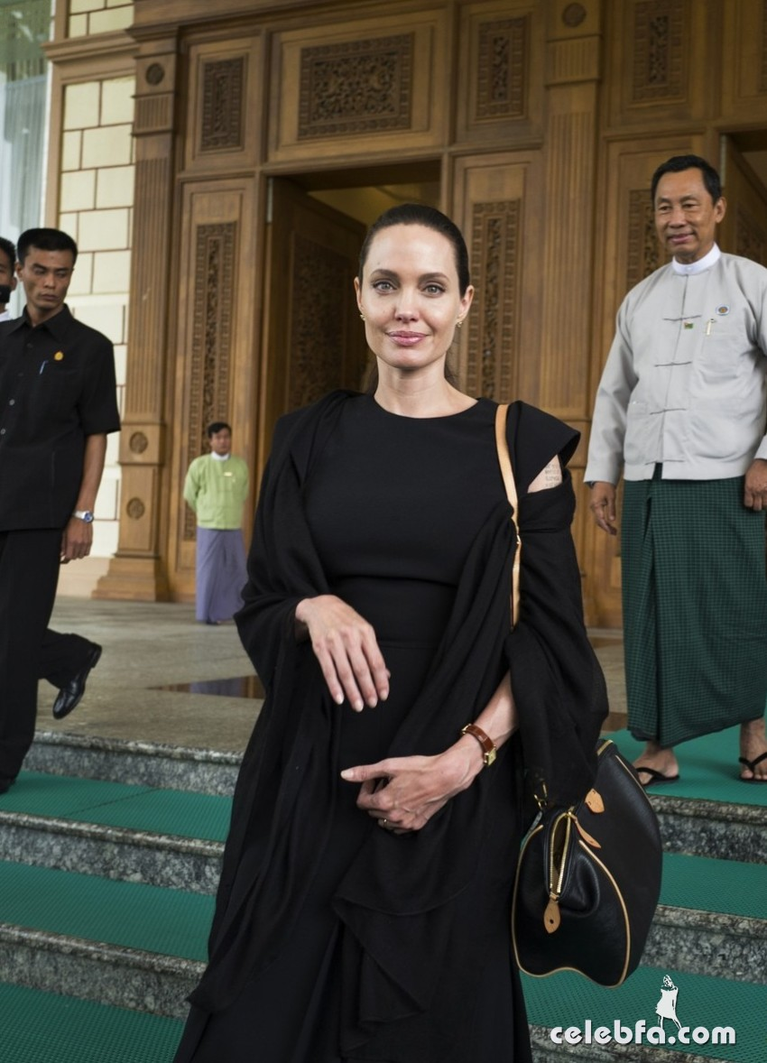 NAY PYI TAW, MYANMAR - JULY 28:   In this handout photo provided by the Maddox Jolie-Pitt Foundation, actress and activist Angelina Jolie Pitt leaves the Myanmar Parliament building after meeting with the Speaker of the lower house, the Burmese House of Representatives, Mr Thura Shwe Mann during the first day of her visit to the region on July 28, 2015 in Nay Pyi Taw, Myanmar. Angelina Jolie Pitt is a Special Envoy of UN High Commissioner for Refugees since her 2012 appointment.  (Photo by Tom Stoddart/Getty Images Reportage/Maddox Jolie-Pitt Foundation via Getty Images)