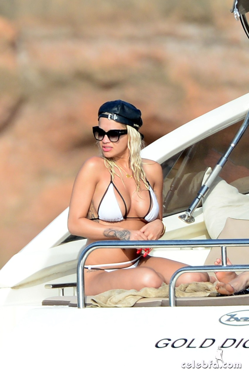 Rita Ora treated her friends to a boat trip to Formentera, The singer showed off her slim figure in a white bikini while enjoying the Spanish sun. Rita seemed to have had a great day as she was seen bursting in laughter though out the boat trip. 3 August 2015. Please byline: Vantagenews.co.uk