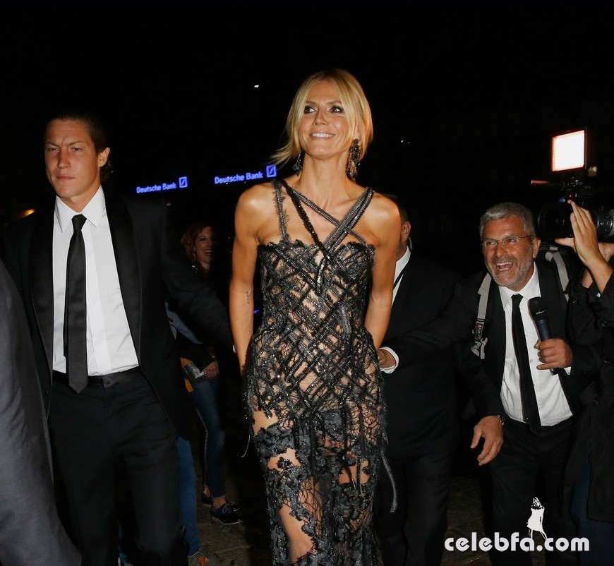 MILAN, ITALY - SEPTEMBER 26: Heidi Klum arrives at amfAR Milano 2015 at La Permanente on September 26, 2015 in Milan, Italy. (Photo by Tristan Fewings/Getty Images for amfAR)