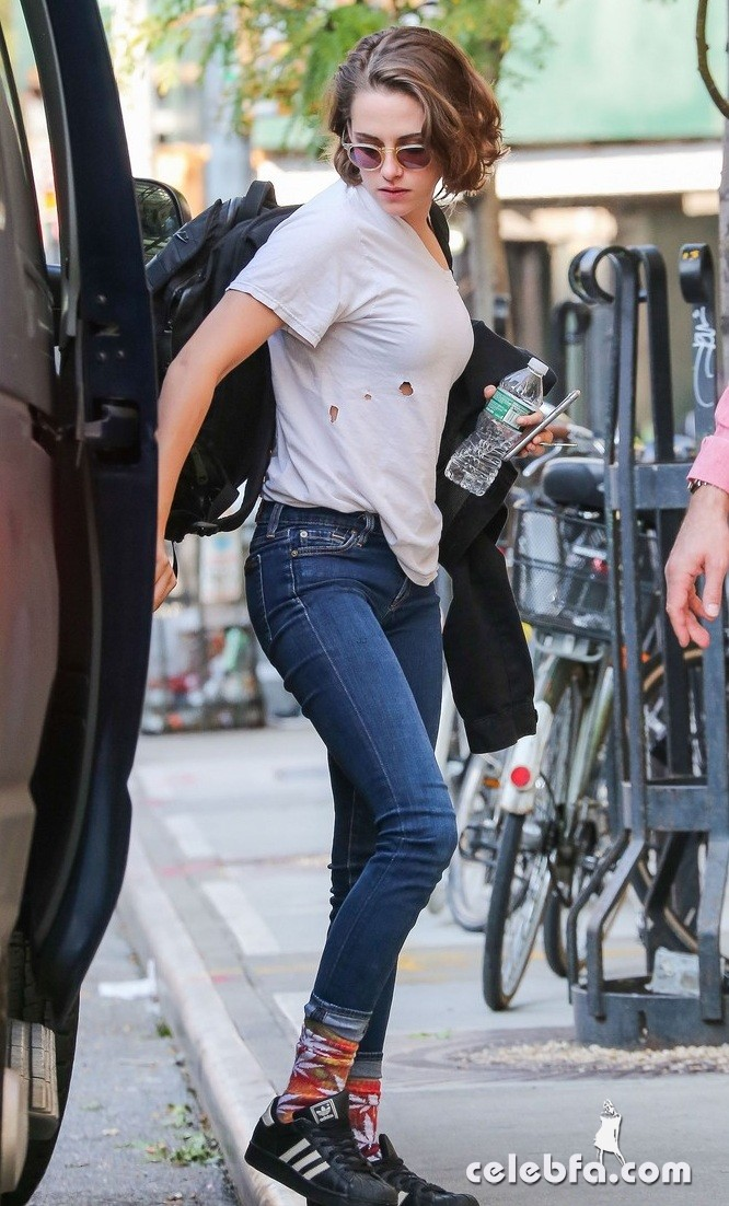 Exclusive... 51874248 'Twilight' actress Kristen Stewart spotted out and about in New York City, New York on October 8, 2015. Kristen could be seen wearing a shirt with holes in it and a pair of marijuana leaf socks. FameFlynet, Inc - Beverly Hills, CA, USA - +1 (818) 307-4813