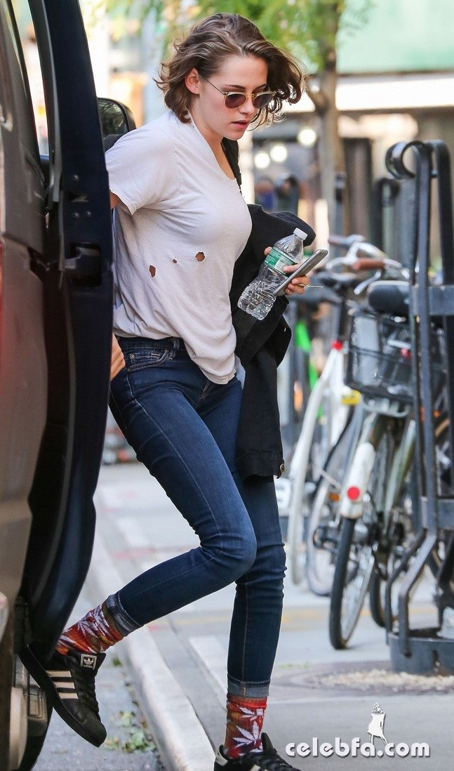 Exclusive... 51874244 'Twilight' actress Kristen Stewart spotted out and about in New York City, New York on October 8, 2015. Kristen could be seen wearing a shirt with holes in it and a pair of marijuana leaf socks. FameFlynet, Inc - Beverly Hills, CA, USA - +1 (818) 307-4813