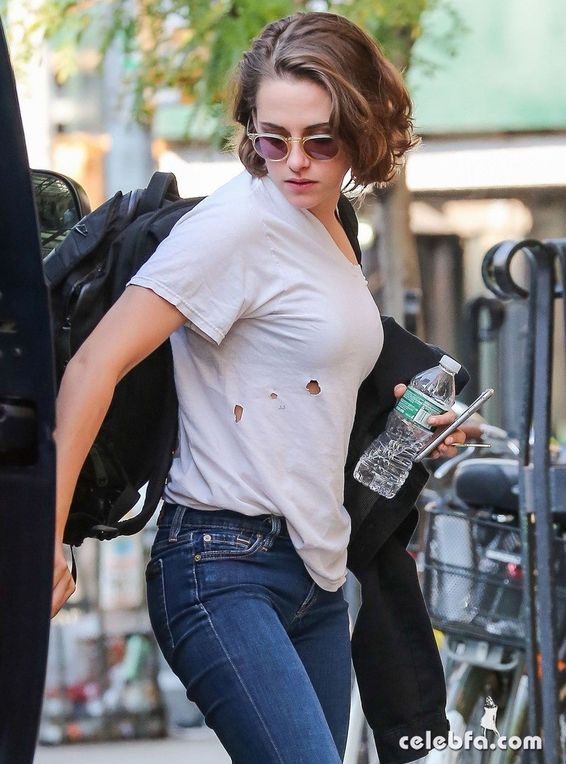 Exclusive... 51874249 'Twilight' actress Kristen Stewart spotted out and about in New York City, New York on October 8, 2015. Kristen could be seen wearing a shirt with holes in it and a pair of marijuana leaf socks. FameFlynet, Inc - Beverly Hills, CA, USA - +1 (818) 307-4813