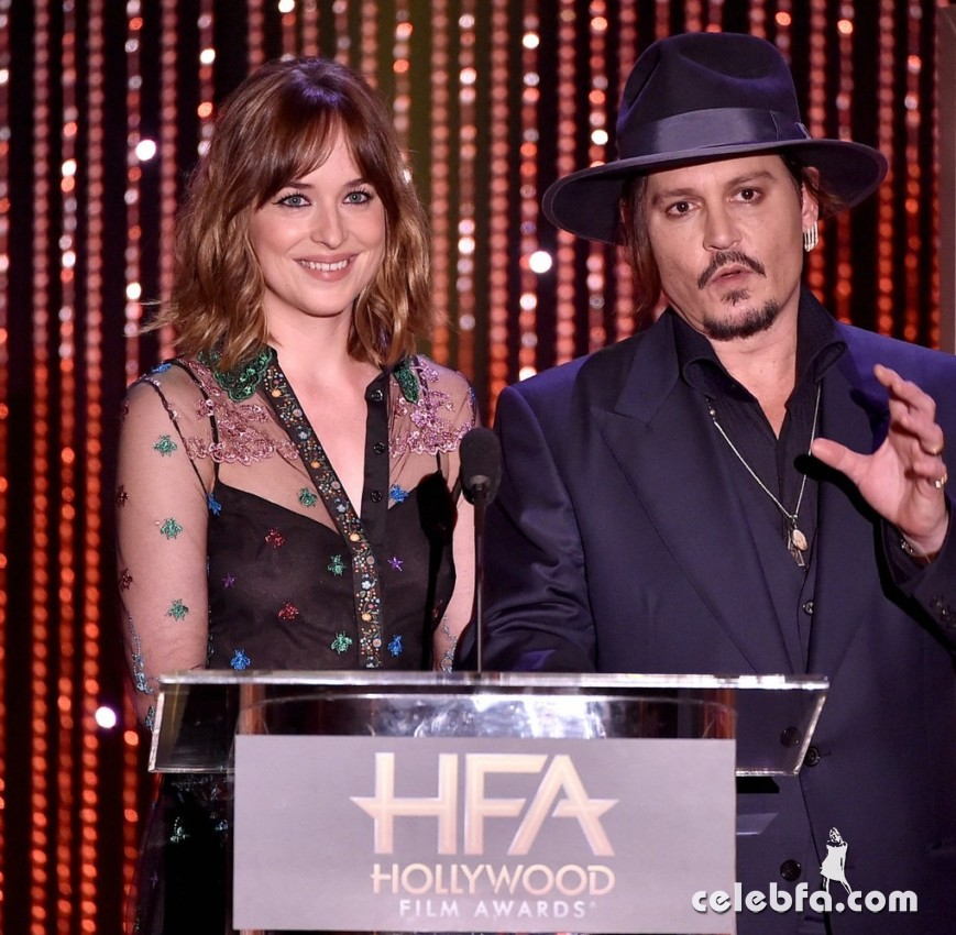 BEVERLY HILLS, CA - NOVEMBER 01:  Actress Dakota Johnson (L) and actor Johnny Depp speak onstage during the 19th Annual Hollywood Film Awards at The Beverly Hilton Hotel on November 1, 2015 in Beverly Hills, California.  (Photo by Kevin Winter/Getty Images)