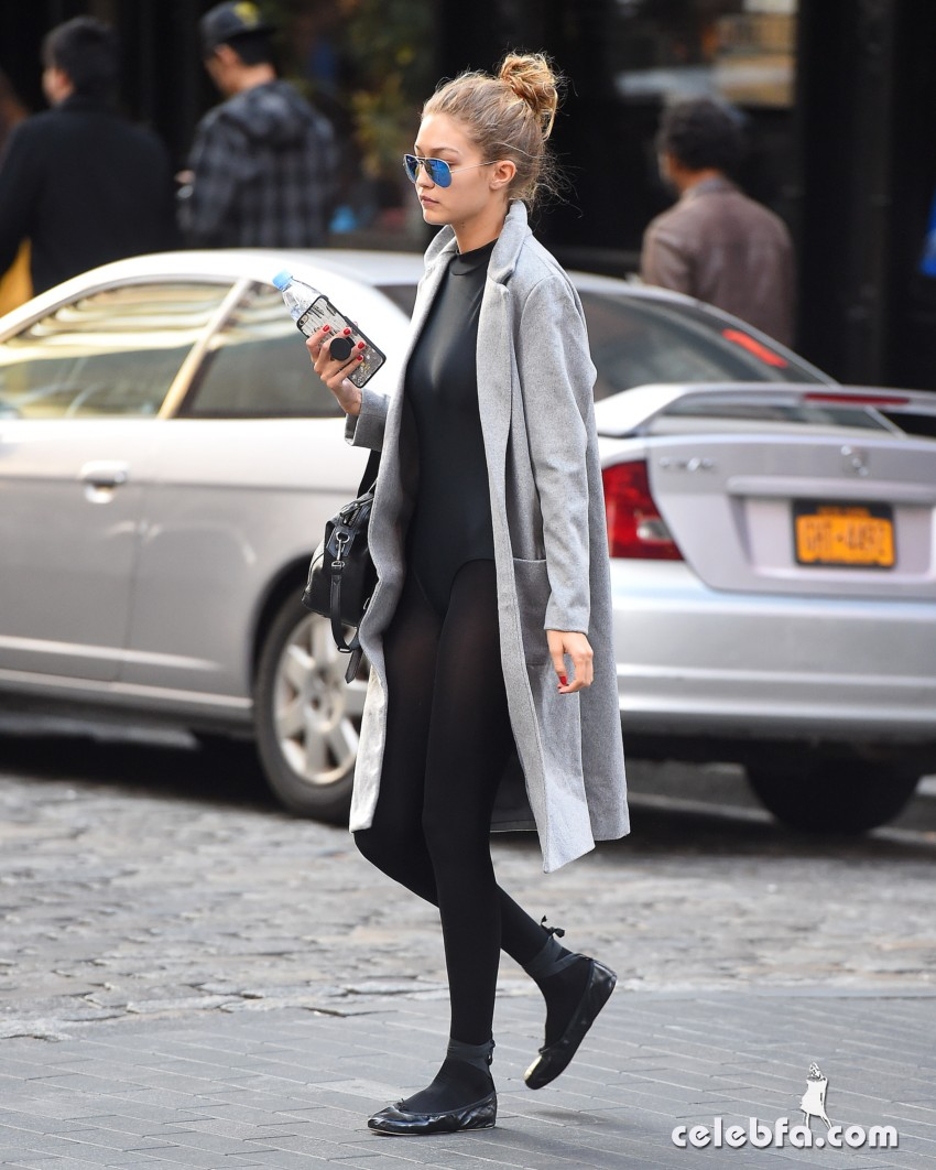 Gigi Hadid seen wearing a black leotard,ballet slippers and a grey coat in New York City