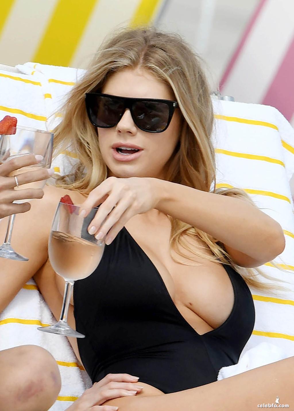 Charlotte McKinney Suffers A Wardrobe Malfunction On The Beach In Miami