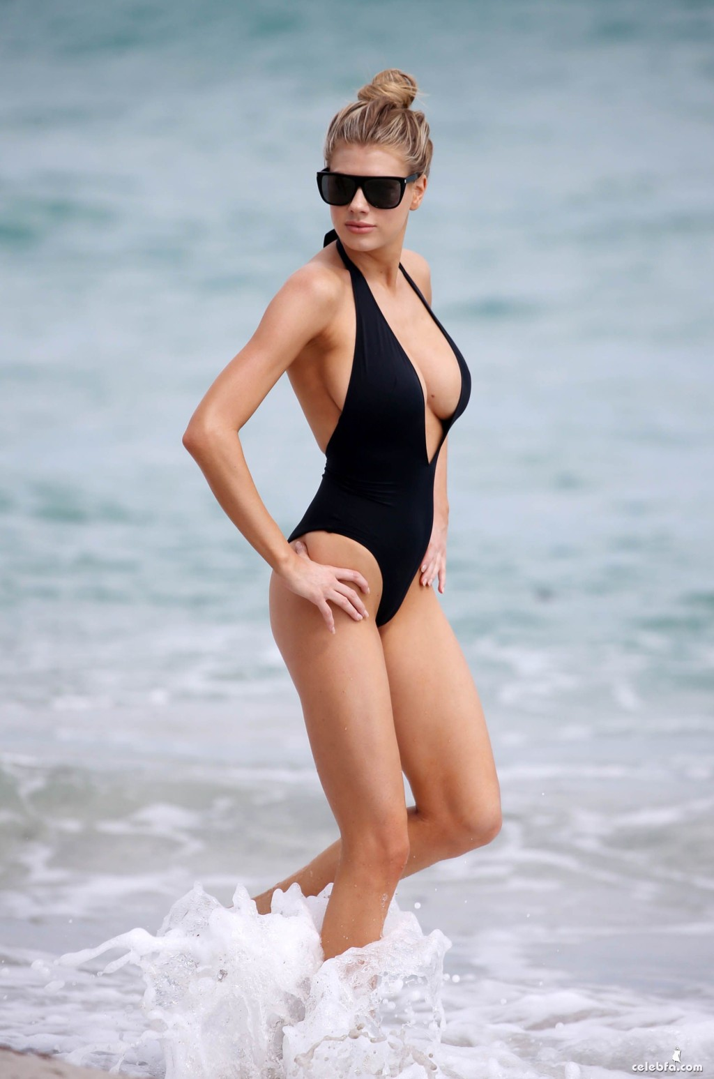 Charlotte McKinney Suffers A Wardrobe Malfunction On The Beach In Miami